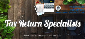Tax Return Specialists Computer on desk with toy car